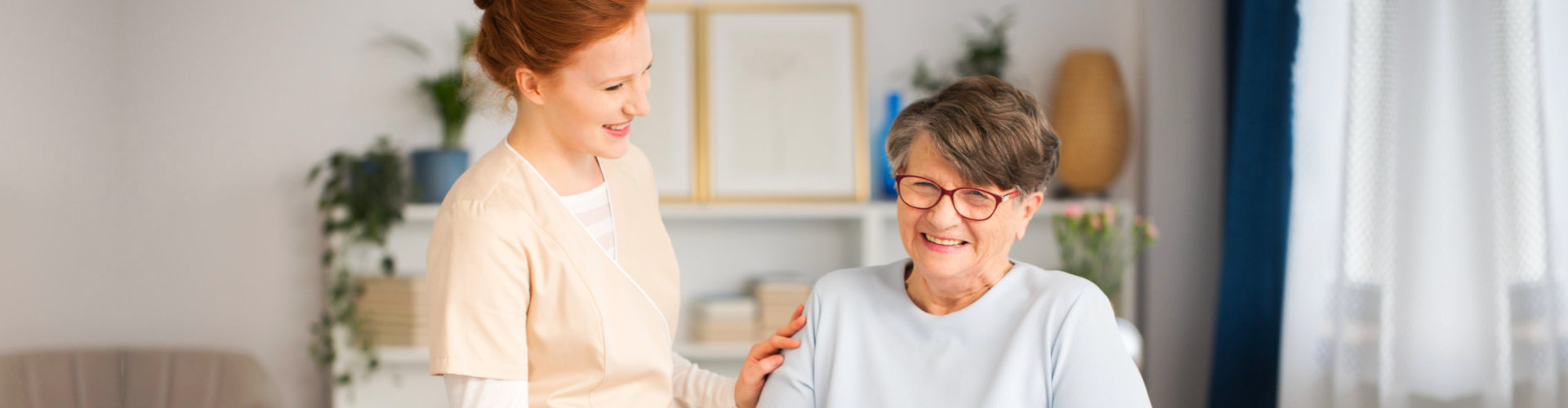 caregiver smiling with the elder lady